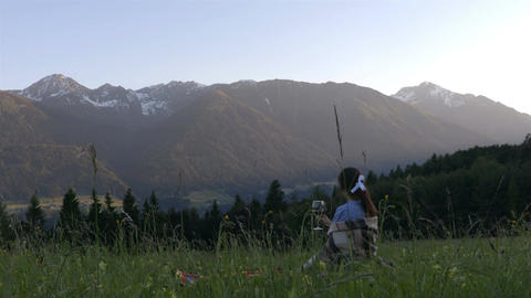 Girl drink whine on the picnic in the alps Footage