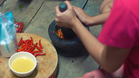 Cooking thai spicy sauce of chili pepper slow motion Footage