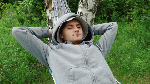 Young man relaxing in hammock Footage