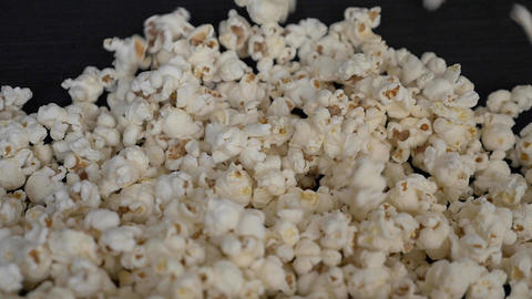 Frontal shot of Popcorn falling in slow motion Footage
