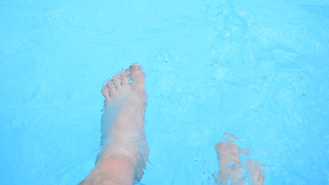 Refreshing feet in a pool Filmmaterial