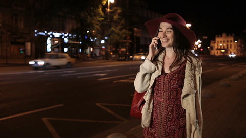 Beautiful girl using smortphone on street at night Footage