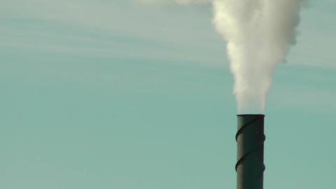 Smoke Stack Against a Slightly Clouded Background 2 Footage