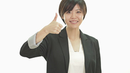 Asian Businesswoman Giving Thumbs Up stock footage