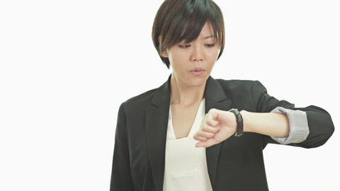 Businesswoman staring at watch in disbelief Live Action