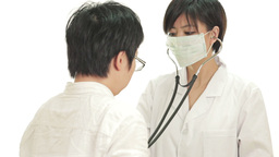 Chinese doctor checking heartbeat with stethoscope Footage
