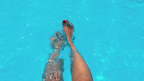 Beautiful Girl Relaxing Her Feet In Pool Water In Summer Filmmaterial