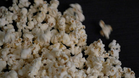 Popcorn falling into slowmotion close up side shot Footage