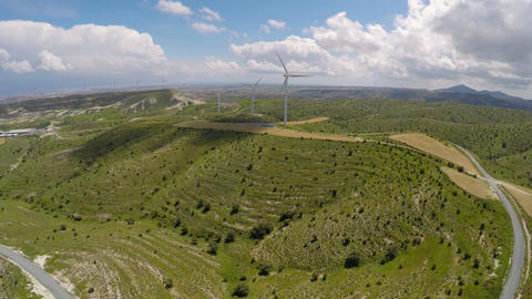 Alternative energy sources at Mediterranean, bird's-eye view of wind turbines Footage