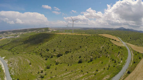 Contemporary wind power plant in mountains, eco-friendly power generation Live Action