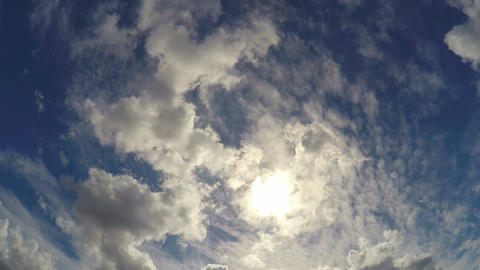 POV of person lying on ground and looking up to the sky, clouds floating by Footage