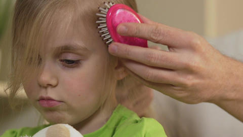 Father combing daughter's hair, sad little girl and her dad, family and care Footage
