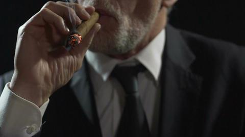Arrogant gangster smoking expensive Cuban cigar, dangerous mafia, slow-motion Footage