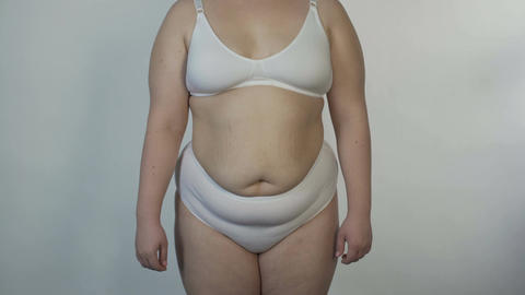 Overweight woman wearing undies posing for camera and turning around, obesity Footage