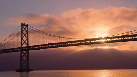 Sun Rises Behind The Bay Bridge Footage