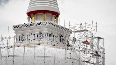 Close up of the workers group are restored. Repair of the old pagoda ビデオ