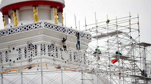 Close up of the workers group are restored. Repair of the old pagoda Footage