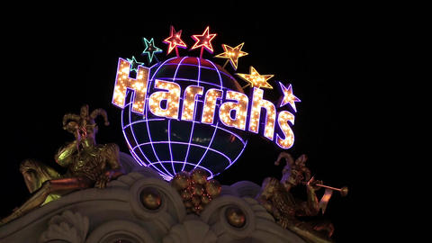 Sign of the hotel Harrahs flashes at night Footage
