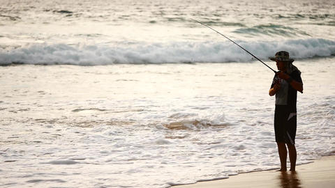 The silhouette fisherman are fishing on the beach. Monsoon season Fishing is a Footage