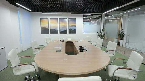 The interior view of a contemporary business office with financial documents lyi Footage