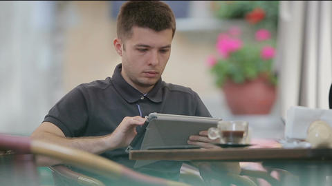 Man using Tablet in Coffee Shop Image
