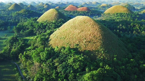 Flyover aerial view of Chocolate hills Live Action