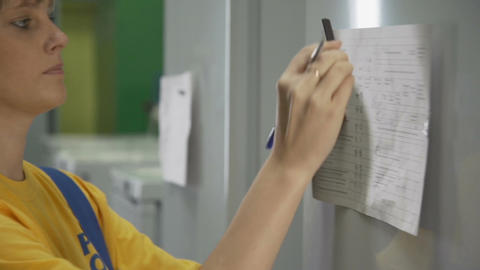 Closeup Young Woman Worker Fixes Paper with Magnet Footage