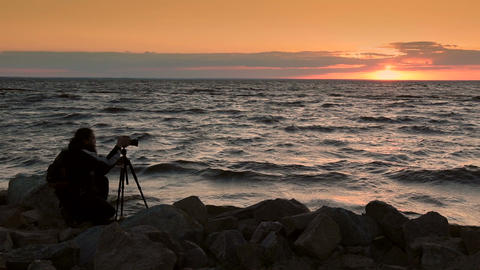 Man photographing beautiful sunset at seaside Footage