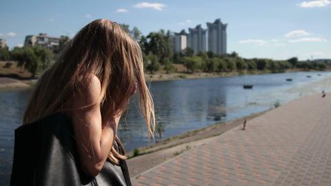 Shocked woman droping smartphone on stone sidewalk