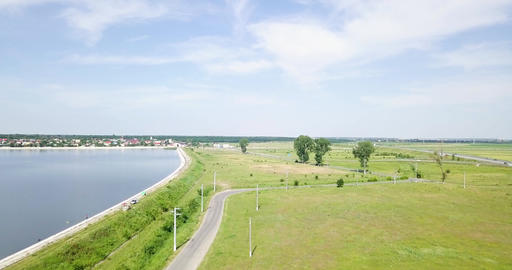 Aerial Drone View Of Small Country Town With Lake On Blue Sky In Summer