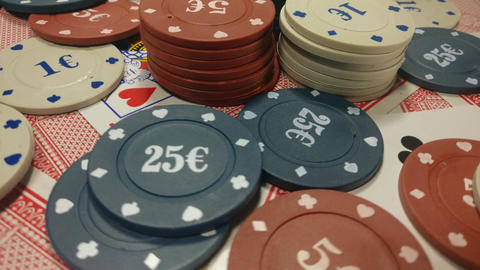 Poker chips and playing cards GIF
