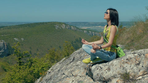 Woman Meditating On Mountain Top Footage