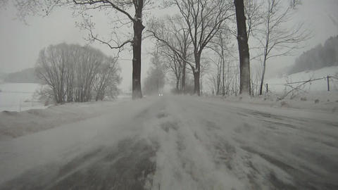 Driving car on snow Footage