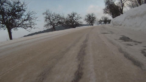 Driving car on snow Live Action