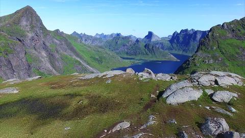 Flying above hikers on Lofoten islands in Norway Footage