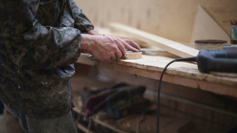 The carpenter measures with a ruler and pencil making marks Footage