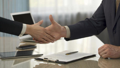 Male signing business agreement, shaking hands with partner, partnership, deal Footage