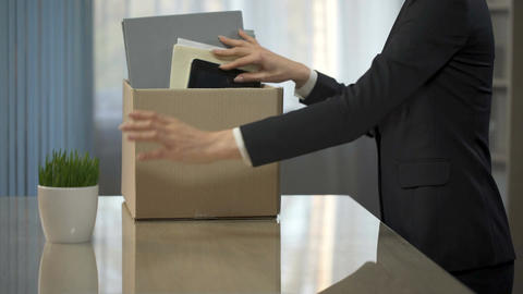 Woman putting her things from office desk into box, getting promoted, career Live Action