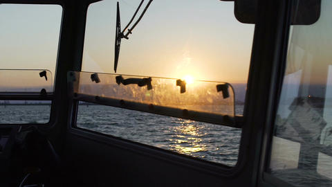 Breathtaking sunset, endless sea view from captain bridge on motorboat, slow-mo Footage
