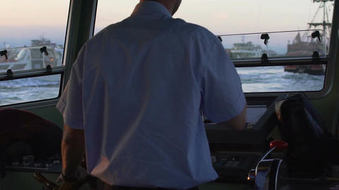 Captain turning steering wheel to control yacht in sea, navigation, slow motion Footage