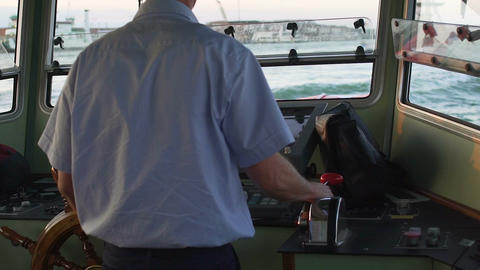 Chief sailor standing at steering wheel, taking course to open sea, voyage Footage