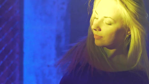 Attractive blonde woman dancing and shaking hair in the night club, relaxation Footage