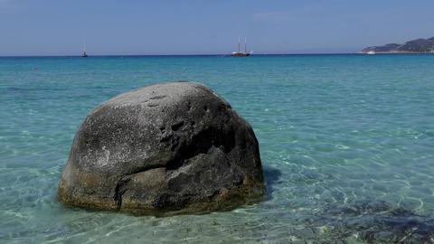 Lone Rock Facing The Mediterranean Sea On Italian Sandy Beach Footage