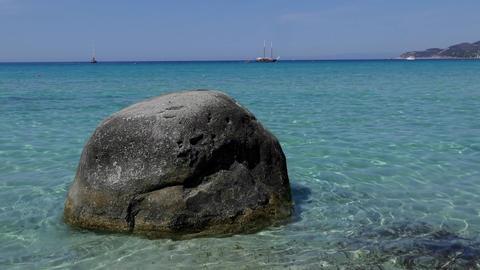 Lone Rock Facing The Mediterranean Sea On Italian Sandy Beach Footage