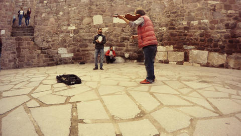 Turkish gypsies play music on different instruments live sound in courtyard of c Live Action