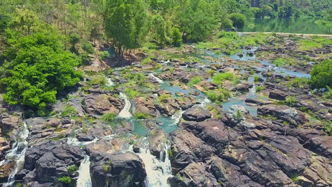 Flycam Shows Rocky Rapids Waterfalls Pongour against Plants Footage
