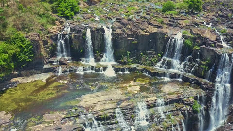 Flycam Opens View of Waterfalls Pongour against Rocks Tropical Plants Footage