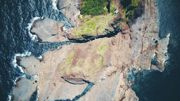 Aerial Bird's Eye Top View of Rocky Island Footage