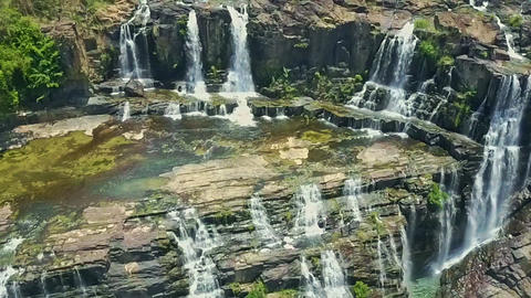 Drone Camera Shows Waterfalls Pongour Flowing from Cliffs Live Action