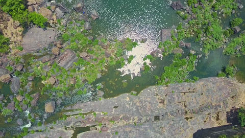 Flycam Moves from Rippled under Sun River to Waterfall Pongour Cascade Footage